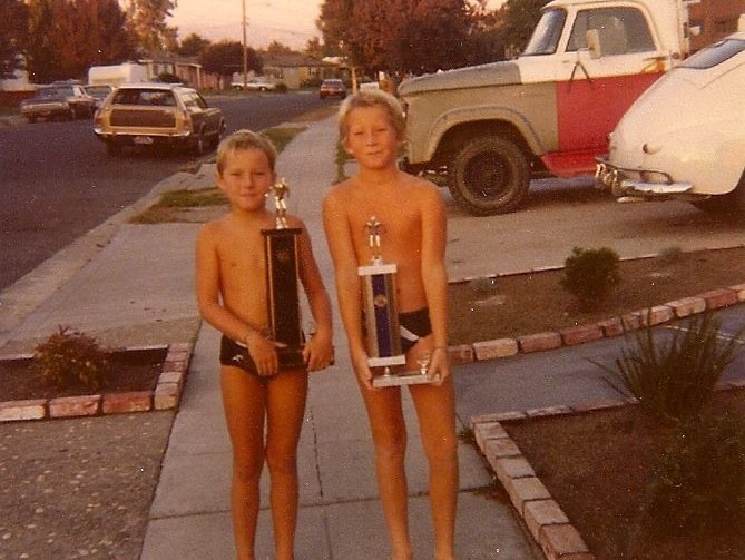Dylan and Yancey with Age Group Swimming Trophies