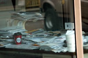 Papers piled on desk, Steve Baker, (CC BY-ND 2.0)