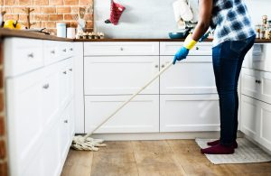 lady mops the floor. Photo by rawpixel on Unsplash