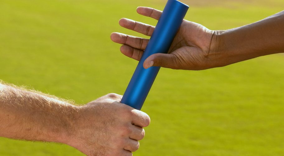 Hands Passing Baton at Sporting Event, photo by tableatny via Flickr.ac
